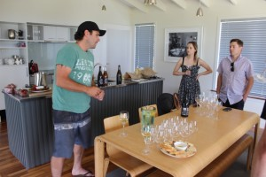 Hayden tasting barrel samples of the skin-fermented wines with the team
