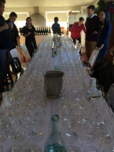 The table is set for 20 guests, each tasting 15 wines. That's a lot of glassware!