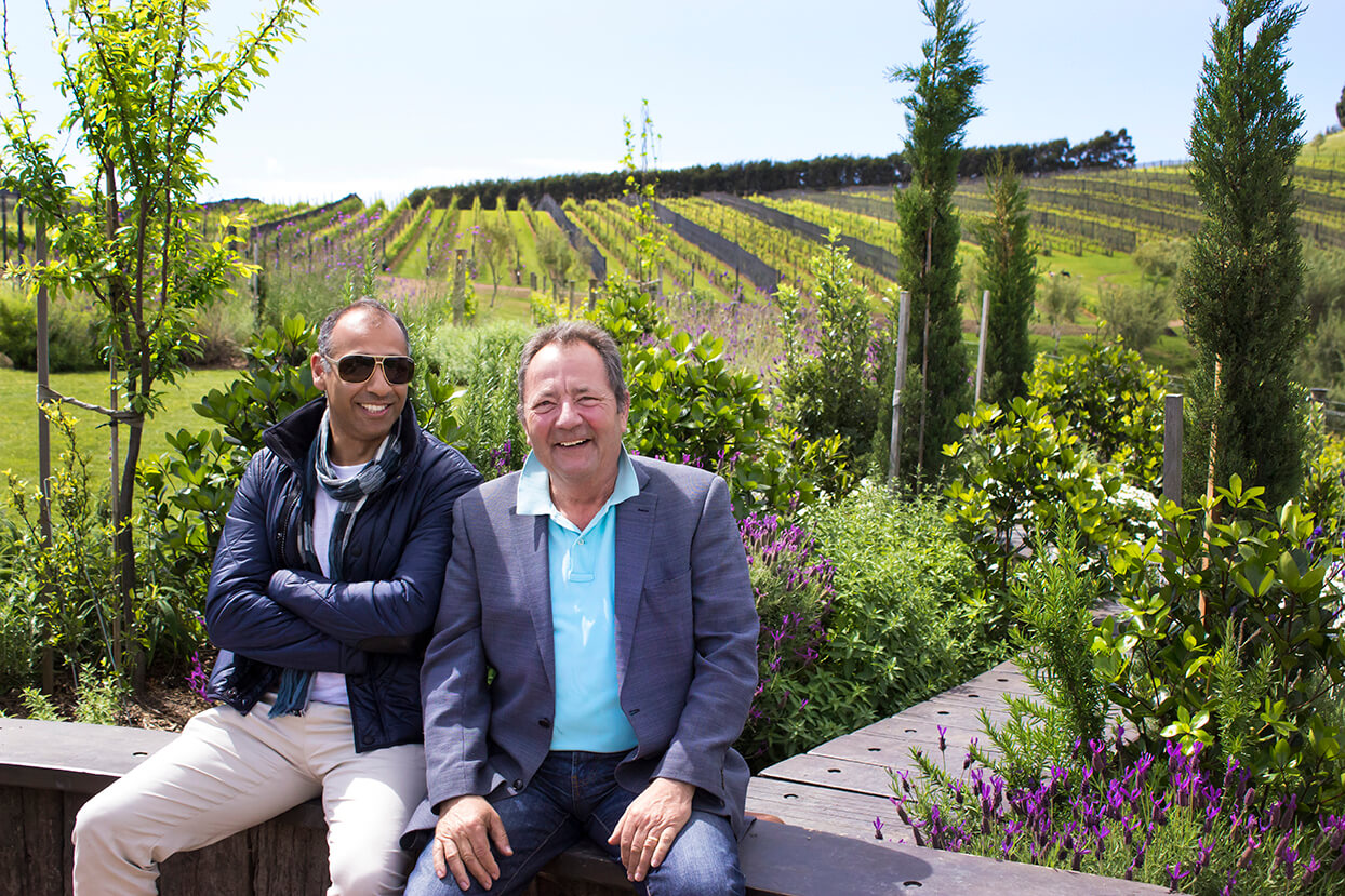 JJ and Puneet enjoy the sun and the vines on the Sensational Waiheke Island