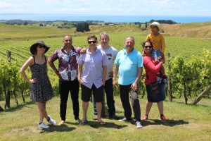 The Dhall & Nash team, with the Sauvignon Blanc and Pinot Gris vines in the background.