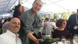 Takaki pours a glass of Champagne Billecart-Salmon for Master Sommelier Cameron Douglas