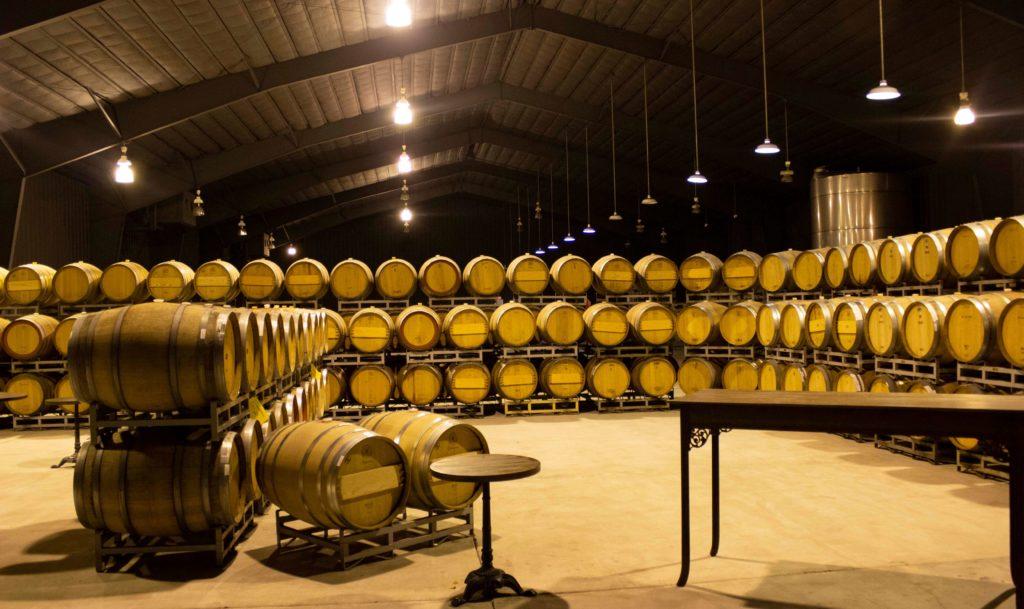 Oak wine barrels at Caymus Winery