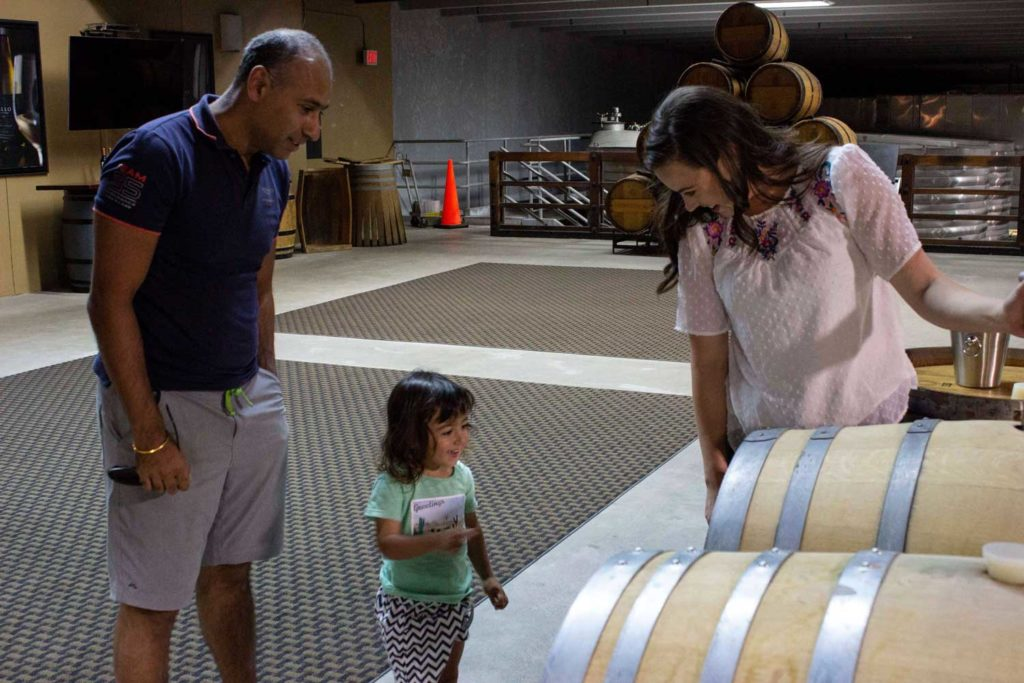 Puneet Dhall and son in Frei Ranch barrel cellar
