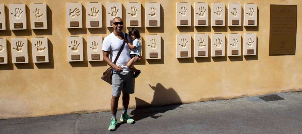 Puneet in front of Stag's Leap Wine Cellars Hands of Time wall