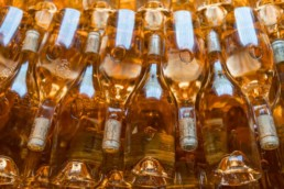 Rose bottles stacked on top of one another