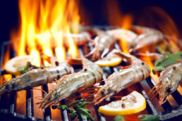 Prawns cooking on barbecue