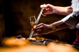 Siphoning Cognac in cellar