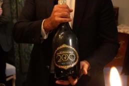 Man holding magnum bottle of Champagne