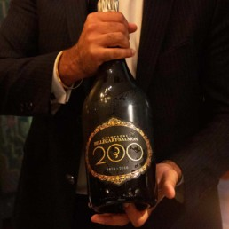 Man holding magnum bottle of Champagne