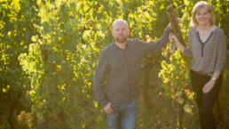 Veronique and Thomas Muré standing in the vineyard